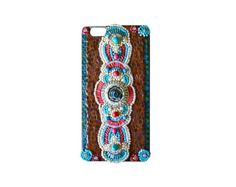 This western Native American Style Iphone 5 cell phone case was built on a hard plastic snap on cover. A focal of running horses has a background of genuine turquoise chips. The spears are turquoise howlite. The edges are lined with glass beads and the case is finished with tiny ceramic tiles. Ready to ship.  I ship USPS priority. Receive it in 2 to 3 days  Please check out my shop for more phone cases, buckles, mosaic art, and jewelry  www.katesutcliffemosaics.com