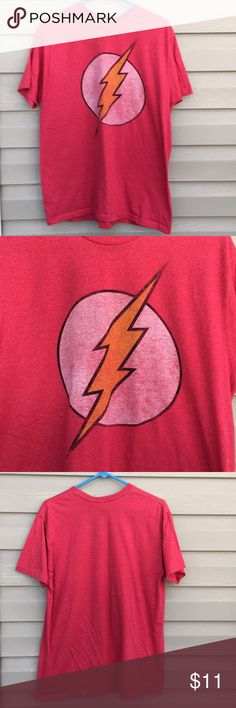 DC comics Avengers Men's red short sleeve shirt Very nice men's red shirt with lightning bolt on front. 60/40 cotton/polyester blend . No snags, stains or holes DC comics Shirts Tees - Short Sleeve