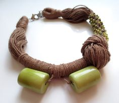 This necklace is made of light brown linen cord ,2 light green cylinder shape tagua nut beads with gloss finish and small yellow round turquoise beads.