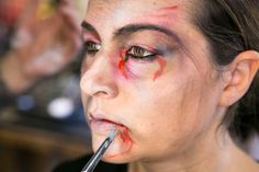 Pin for Later: Transform Yourself Into a Zombie With This Gory Tutorial White Out the Lips Don't for get to add white to your lips, so they lose any healthy colour.