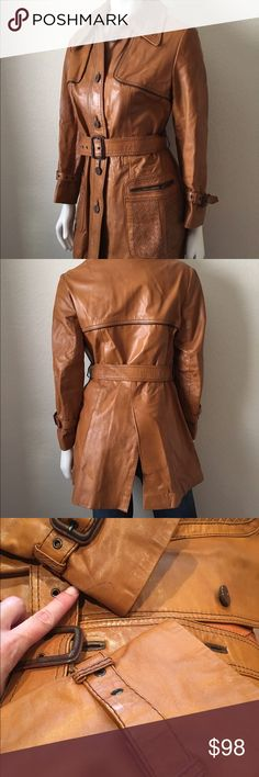"""Boho 1970's era leather coat M Vintage 1970's Leather Jacket is fully lined with two front pockets, front button detail and self fabric waist tie. Size: M Bust: 38"""" Length: 33"""" Waist: up to 34"""" Shoulder to Shoulder: 15"""" 100% Leather. It has one pen mark and one of the sleeves is missing a buckle (no real functionality) as shown on picture. The waist belt buckle keeps falling so a sowing or glueing is recommended. Vintage Jackets & Coats Trench Coats"""