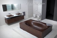 I freaking love this wooden bathroom, especially the tub with the spill over filled with rocks. That is such a cool idea.