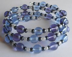 Purple and Blue with Gunmetal/Hematite Color and Pearl Glass Beads on Three Loops of Oval Memory Wire Bracelet by VineDesignBeads