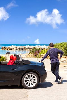 New stock photo available for sale at at Fotolia: Man With Sport Car On The Beach