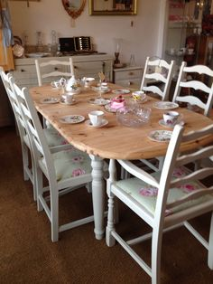 Up cycled solid pine extending table and six upholstered chairs at Rosie Loves Vintage.