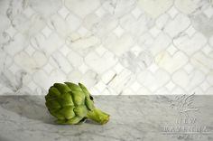 Hearts, a stone mosaic in polished Calacatta Tia and Thassos, is part of the Erin Adams Collection for New Ravenna Mosaics.