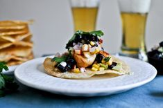Sweet and spicy glazed chicken, corn, and avocado tostadas with blueberry peach salsa