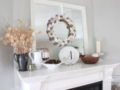 Limit your color choices to create a cohesive look.  A color scheme of white, gray and sand allows a mix of accessories to look unified. Add in a mirror to help the space appear larger and bounce light around the room.