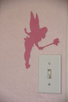 Tinkerbell silhouette over a light switch