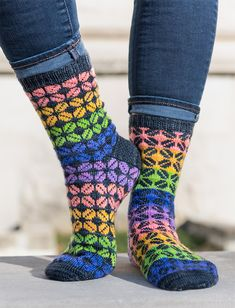 Free Knitting Pattern for Escape Reality Socks - Socks knit with a stranded colorwork coca leaf motif on a striped background of mini skeins, scrap yarn, or a gradient yarn. Sizes Child (Adult M, Adult L). Fingering yarn. Designed by Lisa K. Ross for Knitty.