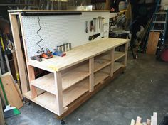 Shop bench and wood storage, with room for 4x8 sheets in the back. Locking wheels for flexibility.