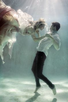 Photographer: Ela Wlodarczyk Designer: Isla Campbell Models: Jennifer Ivey and Adam De La Mare. (dancing underwater.. The next level)