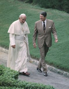 Poles honor Reagan, John Paul II with new statue This Sept. 1987 file photo shows President Ronald Reagan and Pope John Paul II talking as they walk during a visit by the pope to the United States.