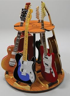 The bottom tier of the 'Carousel Deluxe' multi-guitar stand rotates on a swivel base and can hold up to 6 guitars in only 3 feet of space! More details at https://www.guitarstorage.com