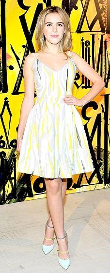 Kiernan Shipka wears a gray, yellow and white-patterned dress by Preen at Jimmy Choo's CHOO.08 launch