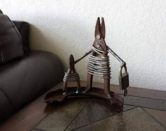 custom made to order welded metal family portrait sculpture