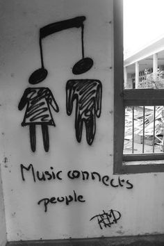 music connects people - I have to admit though, I first saw two people being hung. o.o
