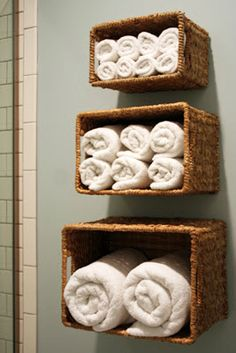Bathroom Towel Storage Ideas: Another way to take advantage of vertical space is by hanging baskets on the wall above the toilet or tub and using them to store towels.