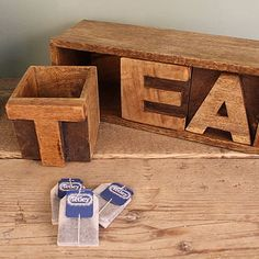 "Tea:  Wooden storage boxes that spell out ""tea"" actually hold loose tea or tea bags."