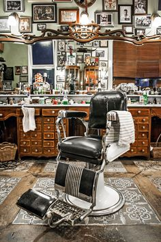 Vintage pomps and quiffs are the speciality of the tattooed cutters at Rotterdam's Schorem, which features antique wooden cabinets. Barber Shop Interior, Barber Shop Decor, Barber Shop Vintage, Barbershop Design, Barbershop Ideas, Barber Chair, Estilo Retro, Wooden Cabinets, Album Design