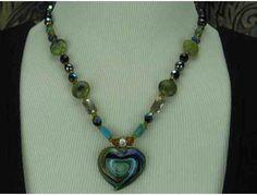 1/KIND Delightful Romantic Necklace w/Agate, Onyx, Hematite, Turquoise/Magnesite, Pendant http://www.biddingforgood.com/ART4GOOD