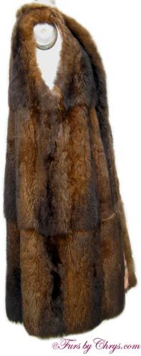Opossum Fur Raincoat and Vest O688; $225 (sale!); Like New Condition; Size range: 8 - 12. This is a beautiful tan raincoat, or trench coat, with a gorgeous genuine natural opossum fur removable lining which can also be used as a fur vest. It has a Bernardo Creations label and features a shawl collar, lightly padded shoulders and the lining of the sleeves is quilted.  The coat closes with buttons, and the full-length opossum fur vest has two side-slit exterior pockets. fursbychrys.com