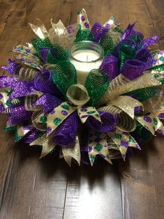 Mardi Gras Centerpiece-Mardi Gras Decor-Mardi Gras Centerpiece - Mardi Gras Decorations - Fat Tuesday Centerpiece- Mardi Gras Candlering - Mardi Gras Centerpiece is made with deco mesh and wired ribbon. Mardi Gras Hats, Mardi Gras Food, Mardi Gras Wreath, Mardi Gras Outfits, Mardi Gras Costumes, Mardi Gras Centerpieces, Mardi Gras Decorations, Masquerade Centerpieces, Branch Centerpieces