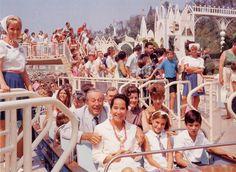 Walt Disney Riding It's A Small World in Disneyland. So adorable!