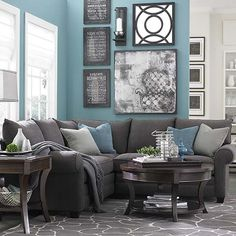 Gray sectional, blue wall, rug, gallery wall