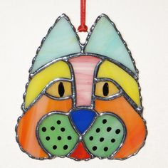 Stained+Glass+Suncatcher++Cat+Head+Cat+of+a+Different+by+GLASSbits,+$26.00