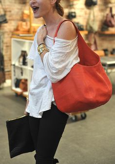 mmmm.... I see this in my future (red purse, white tee, black jeans, black oversize leather clutch)