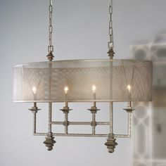 Mesh Screen Shade Chandelier An oval shade of metal mesh diffuses the light in an alluring way on this over scaled chandelier. Blending styles of industrial, modern and transitional creates an edgy architectural focal point over your dining table or island