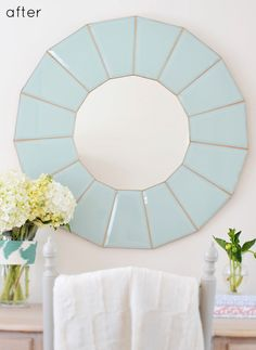 Repurposed mirror made from the panes of those ugly 80s stairway light fixtures that everyone has. Including me. In my new house. Add this to my DIY list...