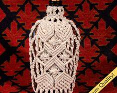 "4 - Macrame Covered Antique Bottle (circa 1930s) Size:9.5""x5""x3"""