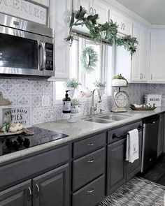 Kitchen Remodel On A Budget Painted kitchen backsplash renovation ideas on a budget using easy DIY tile stencil patterns from Cutting Edge Stencils Modern Farmhouse Kitchens, Home Kitchens, Farmhouse Style, Rustic Country Kitchens, Dream Kitchens, Farmhouse Decor, Kitchen Paint, Kitchen Decor, Kitchen Backsplash Diy