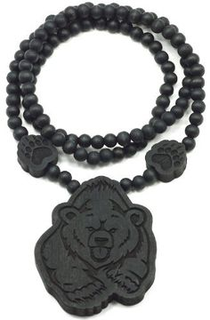Bear Good Wood Goodwood Black Natural Wood Pendant Replica Necklace Piece GWOOD. $9.95. Thicker Than Others With A Clear Detailed Face. Bear Pendant Piece Wood Necklace With Two Bear Paw Wood Inserts On The Bead Necklace. Pendant measures 3 1/4 inches tall by 2 3/4 inches wide. Smooth Finish Back. 36 Inch All Natural Wood Beaded Necklace