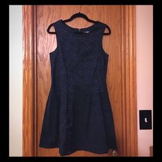 SALE! Forever 21 Contemporary embroidered dress Forever 21 Contemporary line dress.  Dark Emerald green with black accent embroidery.  Skater style.  Worn once to Vegas so obviously it's good luck ;) No rips, stains, or fading. Forever 21 Dresses Midi