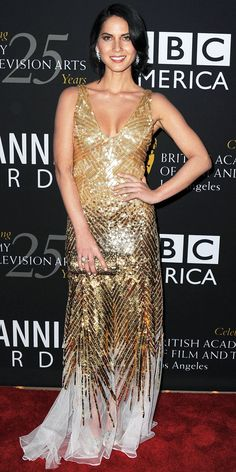 At the Britannia Awards, Olivia Munn sparkled in Temperley London's gold sequin dress and a clutch to match.