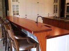 Jatoba edge grain countertop and bar top with custom corbels.