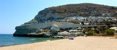 Agua Amarga provides visitors this beautiful beach, clear waters surrounded by cliffs with caves carved into the rock. Beach with lifeguard and services as, showers and bathrooms. Beach Vibes, South Of Spain, Andalusia Spain, Spain Holidays, Cabo San Lucas, Beach Wear, City Beach, Seville, Spain Travel