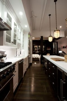 Love the mix of espresso on the bottom and white on the countertops and upper cabinets