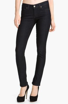 An inky-blue rinse colors skinny stretch jeans finished with tonal topstitching for a clean look.