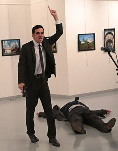 "One of the most impactful photos of my lifetime courtesy of AP. An Islamic radical, standing over the body of the Russian ambassador to Turkey he had just assassinated today at an art exhibit, chanting ""Allahu Akbar.""  Good thing there's no historical precedent for terrorists assassinating a European ambassador igniting a global powder keg."