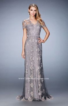 Gorgeous short sleeve evening gown with embroidered overlay and lace underlay. Back zipper closure.