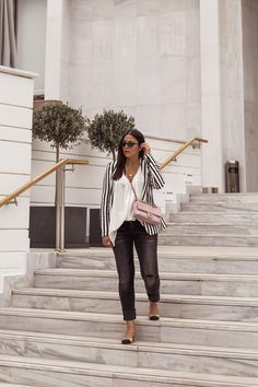Stella Asteria showing how to wear a striped blazer for spring - striped blazer from H