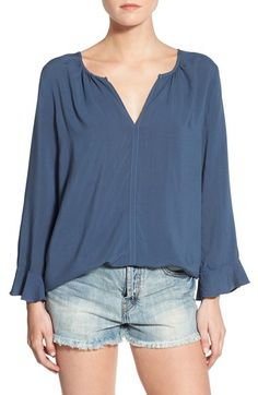 Free shipping and returns on Velvet by Graham & Spencer Challis Peasant Blouse at Nordstrom.com. A split neckline descends to the clean center seam of a romantically draped peasant blouse made from lightweight challis. Ruffled bracelet sleeves enhance the charming look.