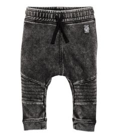 Black washed out. Joggers in soft, washed sweatshirt fabric with an elasticized drawstring waistband. Back pocket, dropped gusset, and tapered legs with
