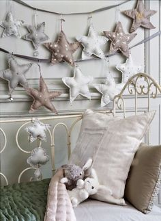So doing in Em's room!!! (These stars would be so cute for a little girls room!! Get a cute star pattern, cut 2 matching patterns, stuff and sew. This would be nice with multiple sizes and patterns. Sew strings on each to hang on long ribbon and attach to the wall! )