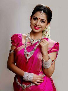 South Indian bride. Indian diamond bridal jewelry. Jhumkis.Pink silk kanchipuram sari.Braid with fresh jasmine flowers. Tamil bride. Telugu bride. Kannada bride. Hindu bride. Malayalee bride.Kerala bride.South Indian wedding.