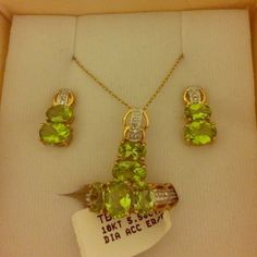 5.50ctw Peridot 4 piece set, earrings, necklace , and ring. The ring is a size 7. New, never even taken out of the box. Perfect for any August birthdays, or someone who loves the color green. Accessories